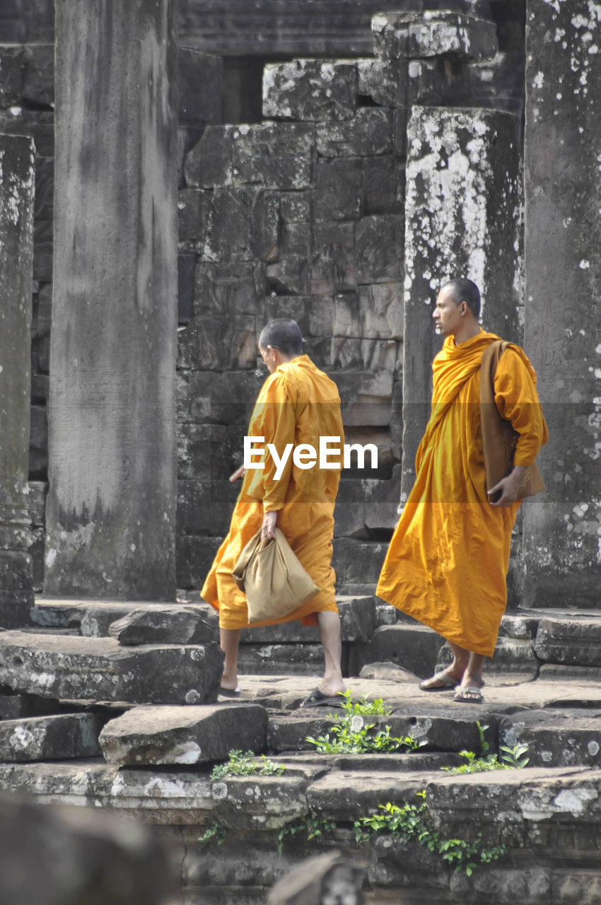 two people, spirituality, full length, religion, rear view, adult, old ruin, architecture, day, people, outdoors, young adult, adults only