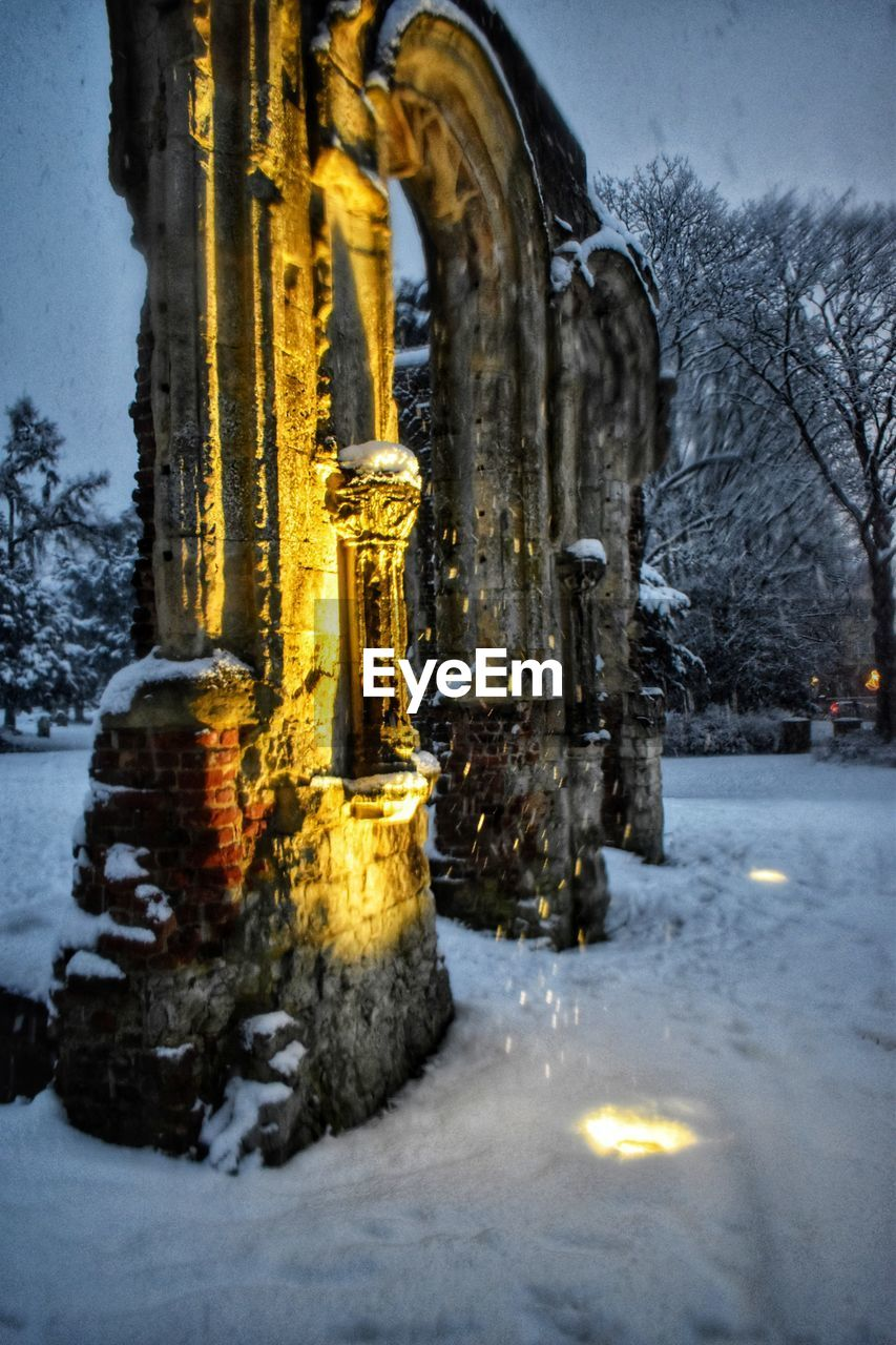 snow, winter, cold temperature, architecture, no people, built structure, nature, building, tree, frozen, reflection, plant, illuminated, building exterior, dusk, water, the past, outdoors, religion, snowing