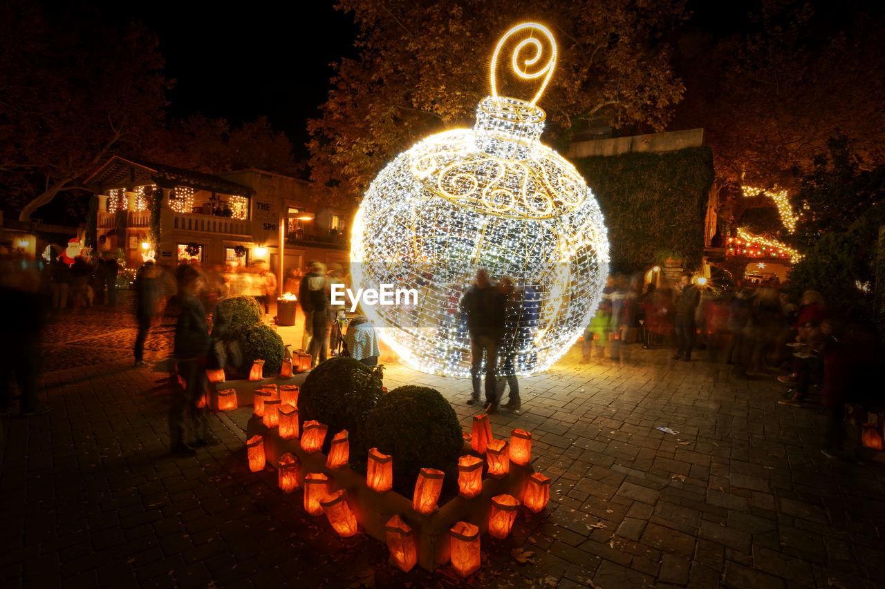 ILLUMINATED CHRISTMAS DECORATION AT NIGHT
