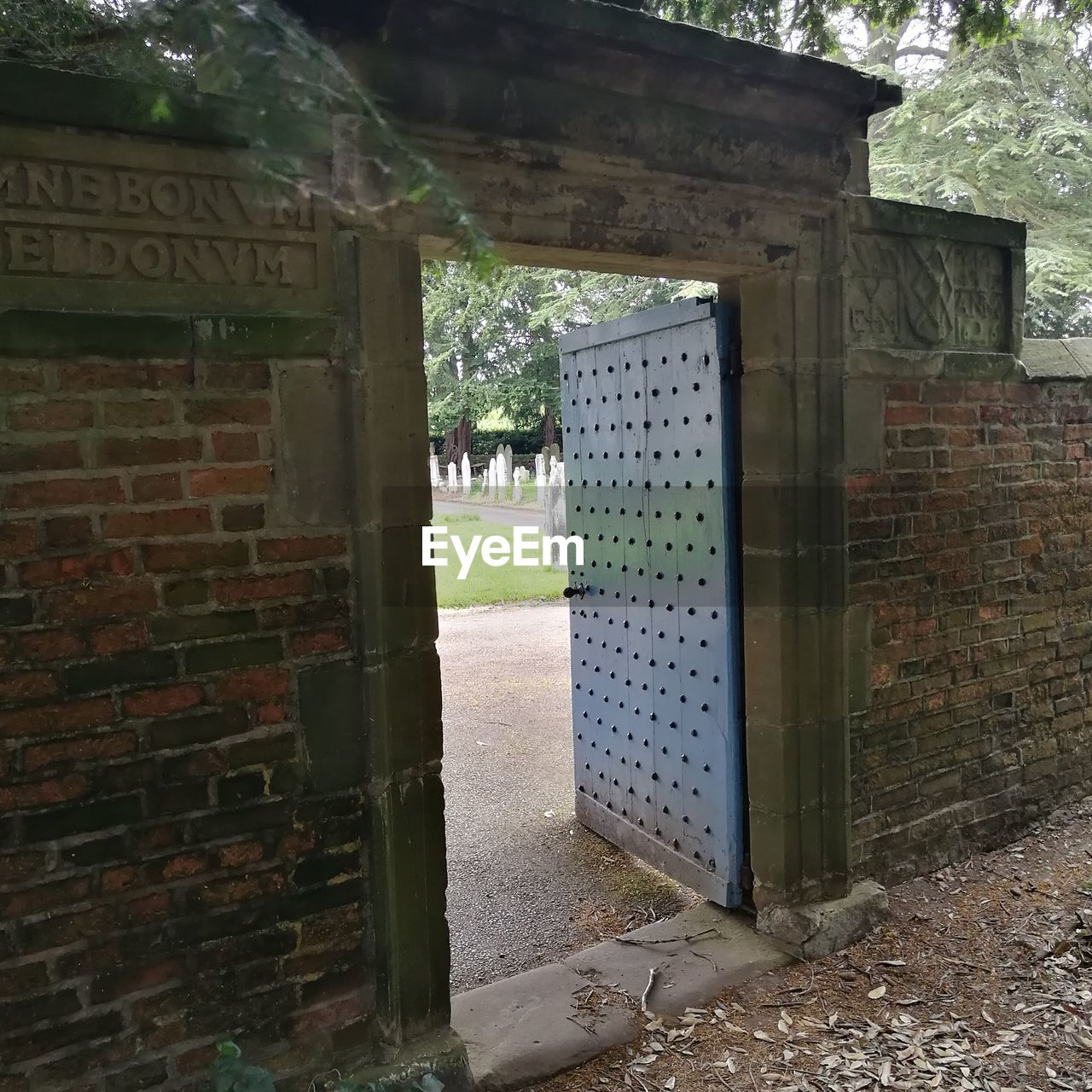 built structure, architecture, door, entrance, building exterior, open, day, no people, doorway, green color, outdoors, entry, open door