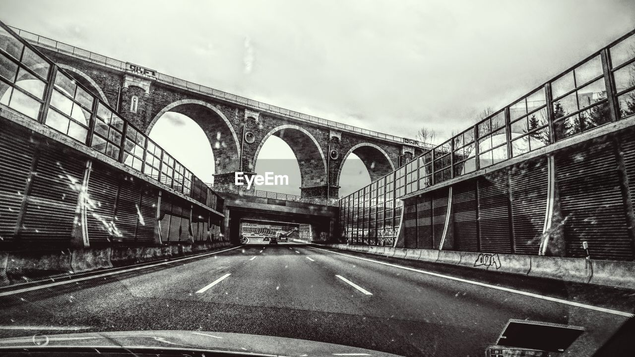transportation, bridge - man made structure, connection, land vehicle, car, road, mode of transport, car interior, built structure, the way forward, architecture, travel, arch, day, sky, cloud - sky, no people, train - vehicle, outdoors