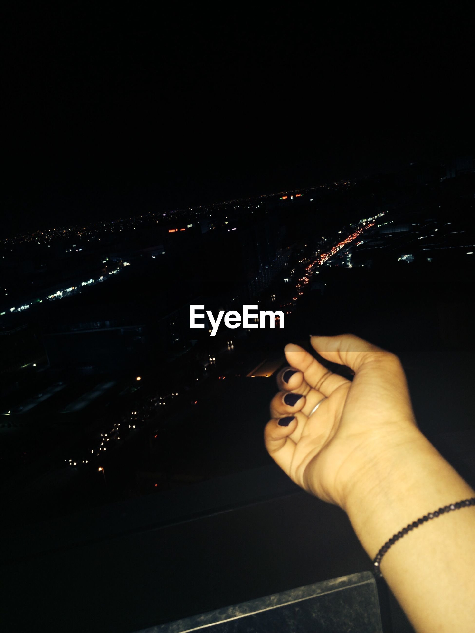 person, part of, personal perspective, night, lifestyles, cropped, leisure activity, low section, indoors, men, human finger, illuminated, high angle view, unrecognizable person, holding