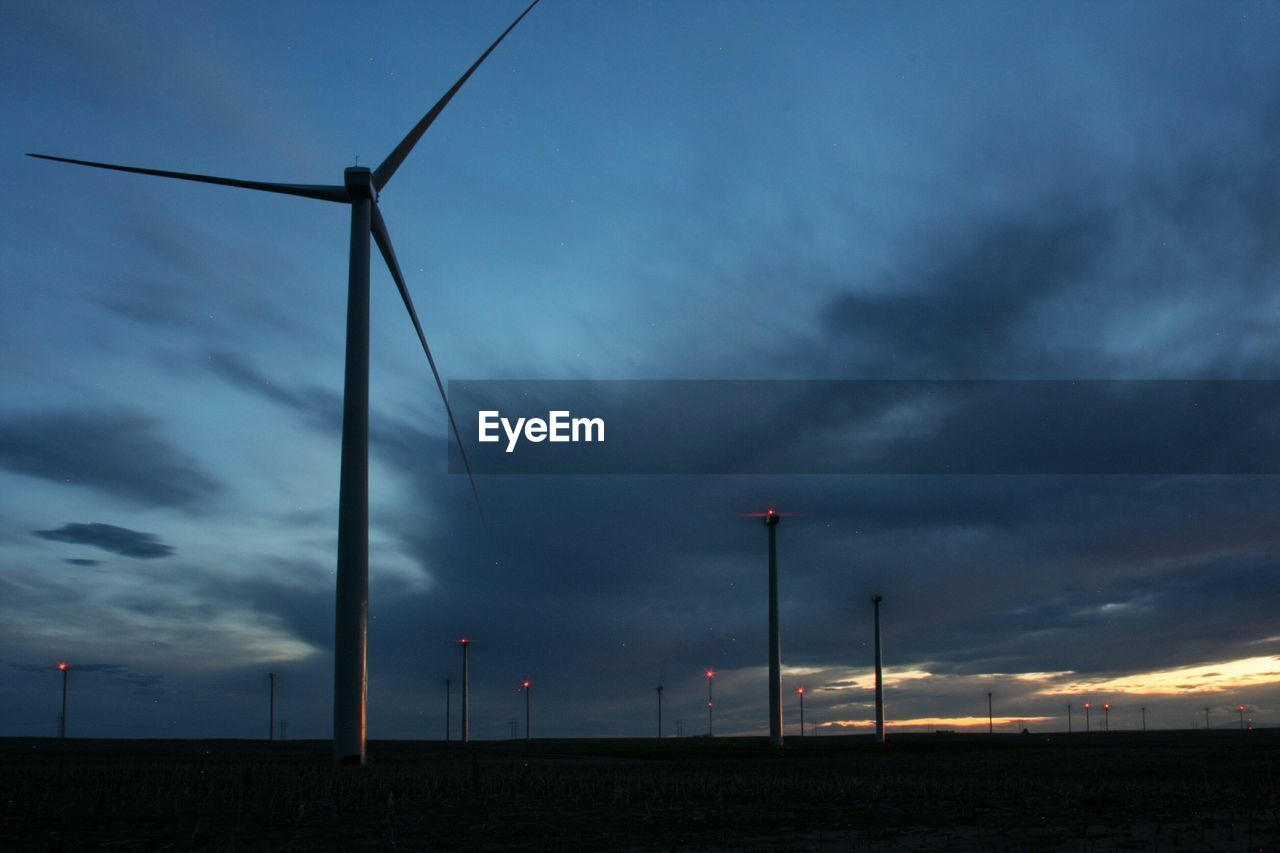 cloud - sky, sky, outdoors, no people, nature, fuel and power generation, tranquil scene, cable, electricity, transportation, sunset, low angle view, electricity pylon, street light, scenics, beauty in nature, wind turbine, wind power, storm cloud, industrial windmill, day, windmill