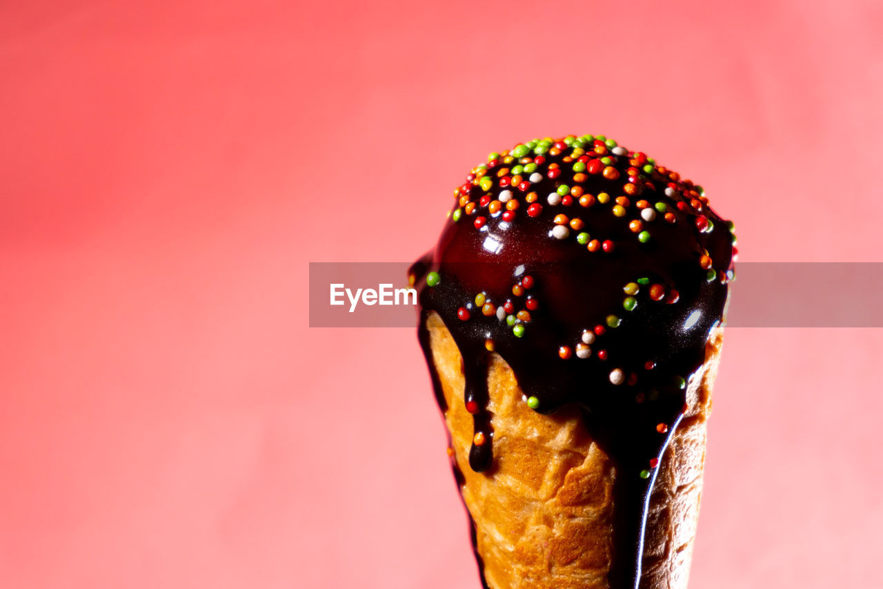 sweet food, food, food and drink, indulgence, sweet, dessert, unhealthy eating, temptation, freshness, colored background, ice cream, studio shot, indoors, still life, frozen food, close-up, dairy product, frozen, sprinkles, ready-to-eat, no people, pink color, frozen sweet food