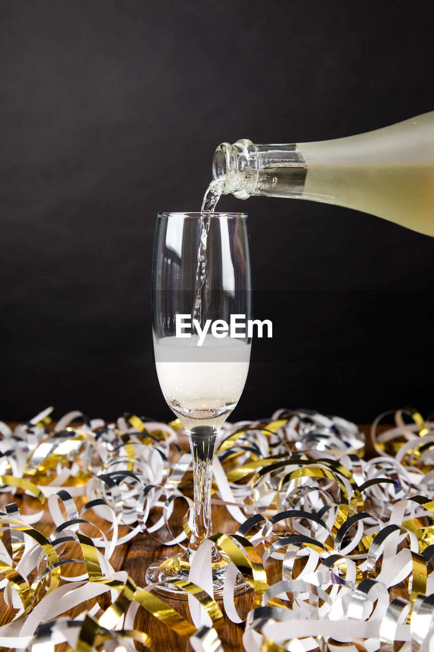 glass, refreshment, drink, food and drink, freshness, alcohol, pouring, glass - material, transparent, drinking glass, wine, wineglass, indoors, black background, no people, still life, food, household equipment, close-up, purity, luxury