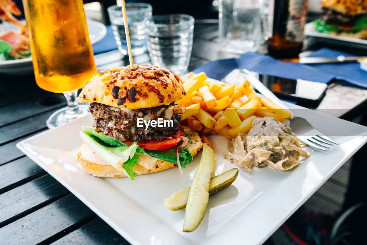 Close-Up Of Hamburger And French Fries In Tray