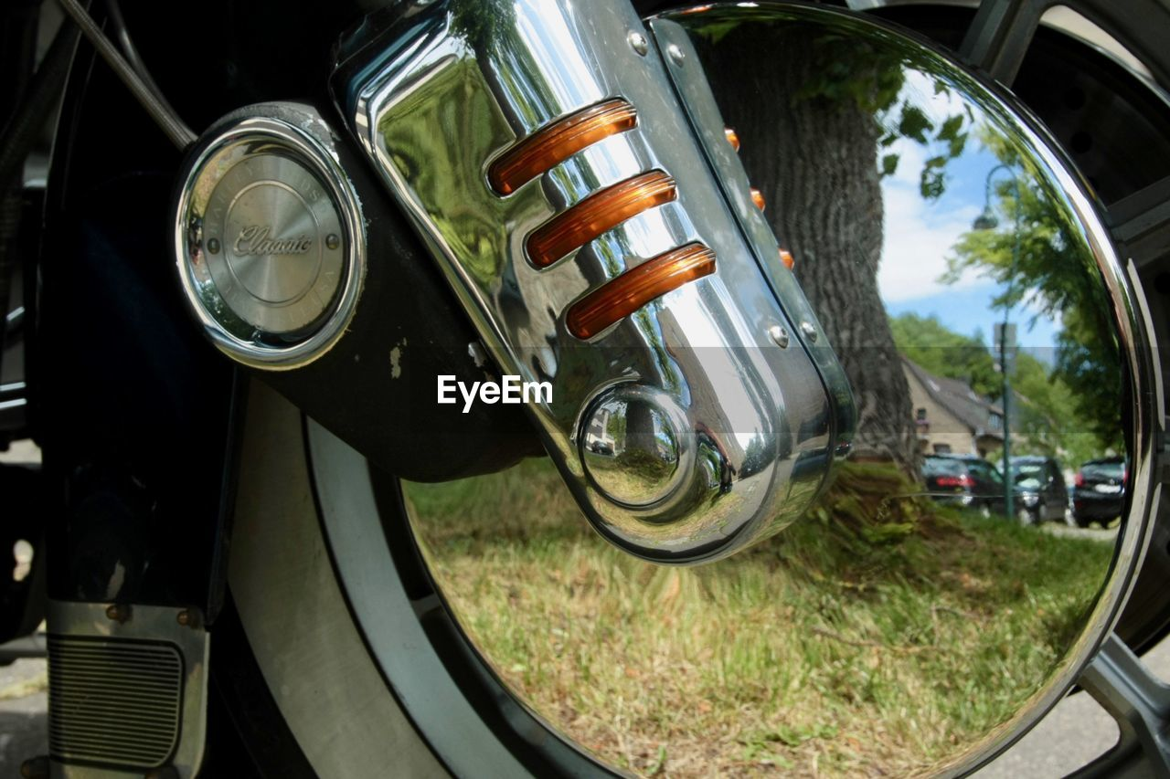mode of transportation, land vehicle, transportation, car, motor vehicle, day, headlight, reflection, metal, close-up, retro styled, outdoors, vintage car, no people, focus on foreground, travel, chrome, stationary, vehicle part, tire, wheel, silver colored, vehicle light