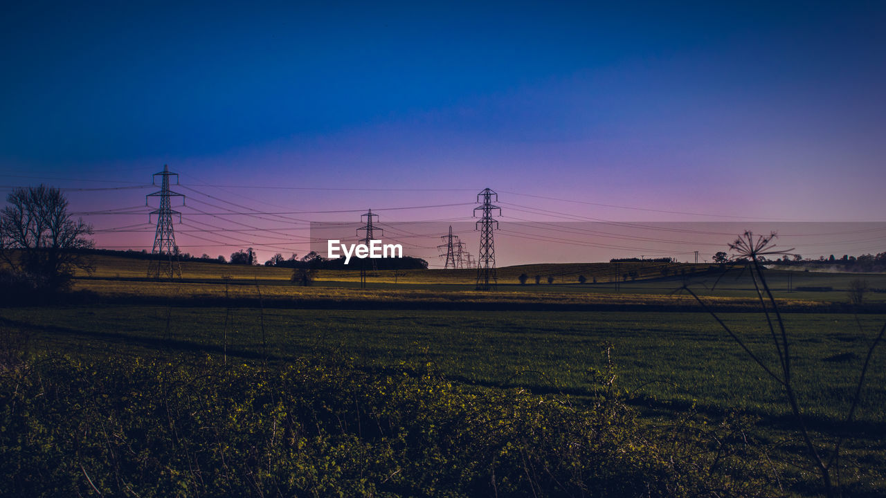 sky, landscape, field, land, electricity, environment, beauty in nature, cable, tranquil scene, scenics - nature, plant, electricity pylon, tranquility, technology, rural scene, nature, power line, no people, power supply, agriculture
