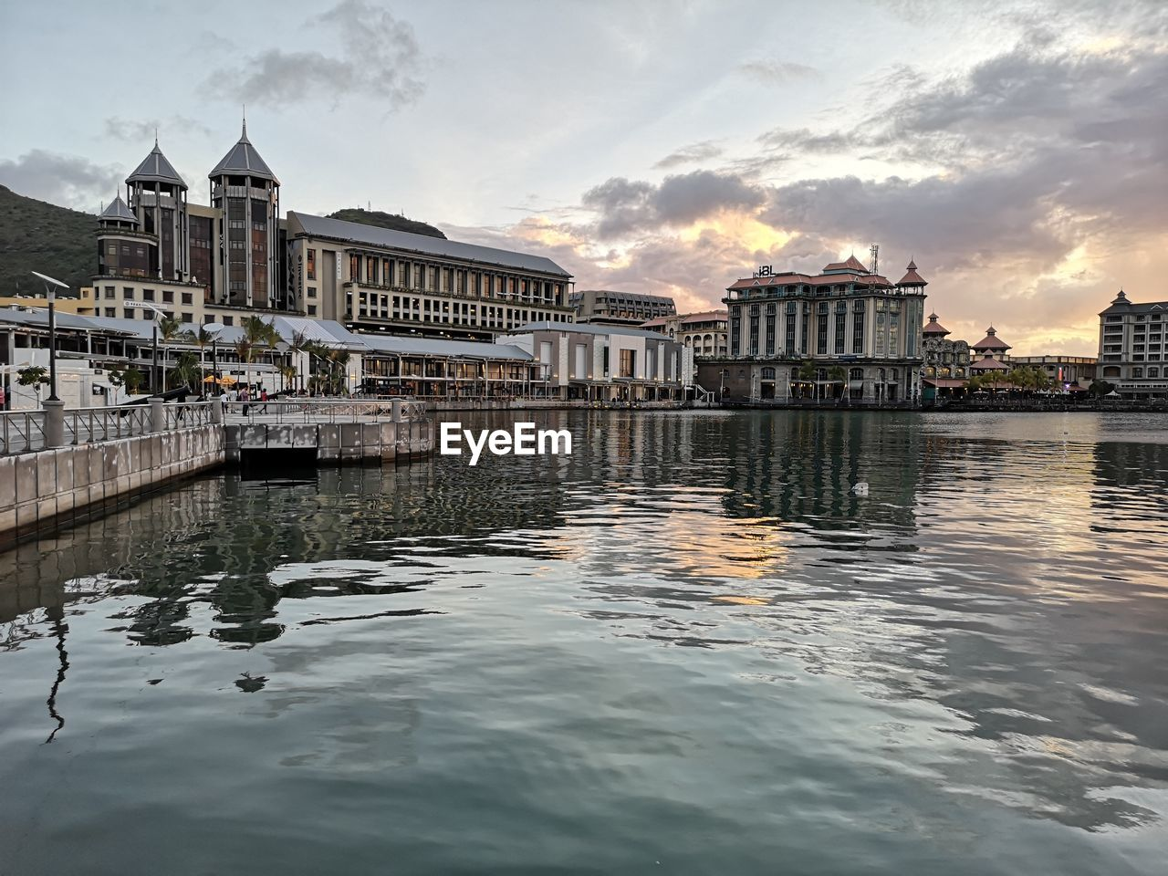 building exterior, built structure, architecture, water, sky, cloud - sky, waterfront, city, building, sunset, reflection, nature, river, no people, residential district, outdoors, dusk, day