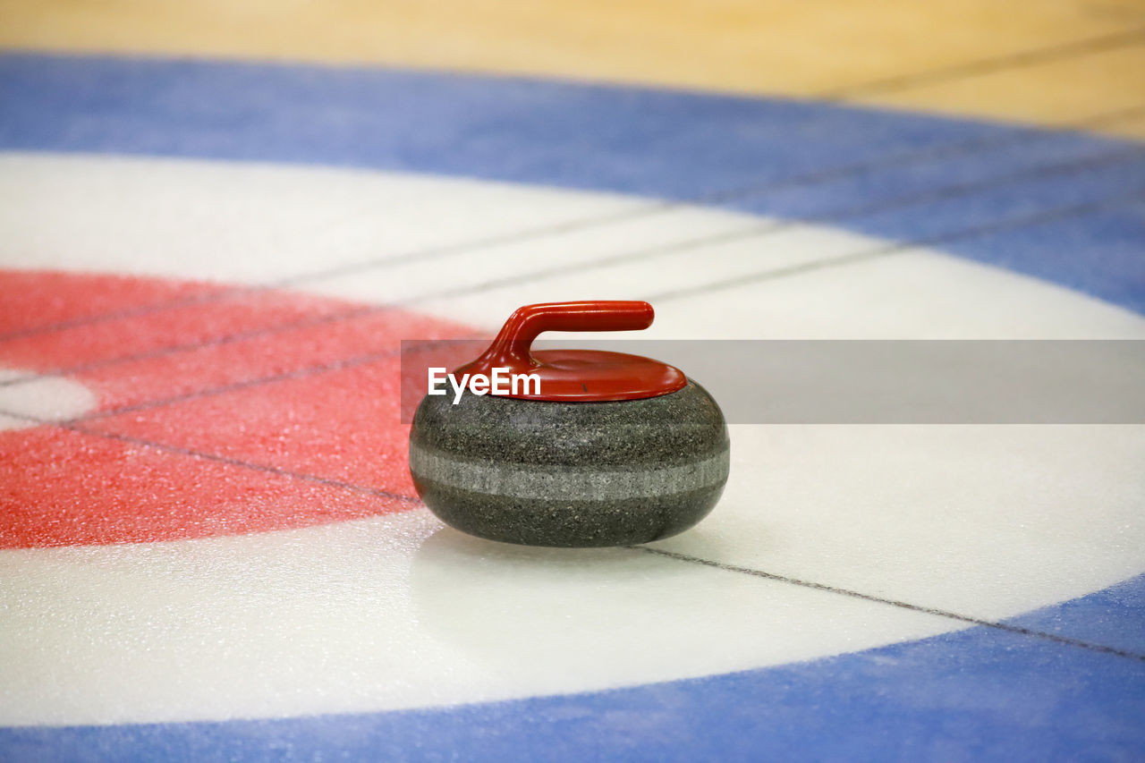 Close-up of curling stone on ice rink