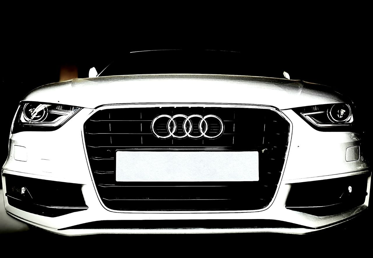 car, headlight, black background, mode of transport, no people, indoors, close-up, day