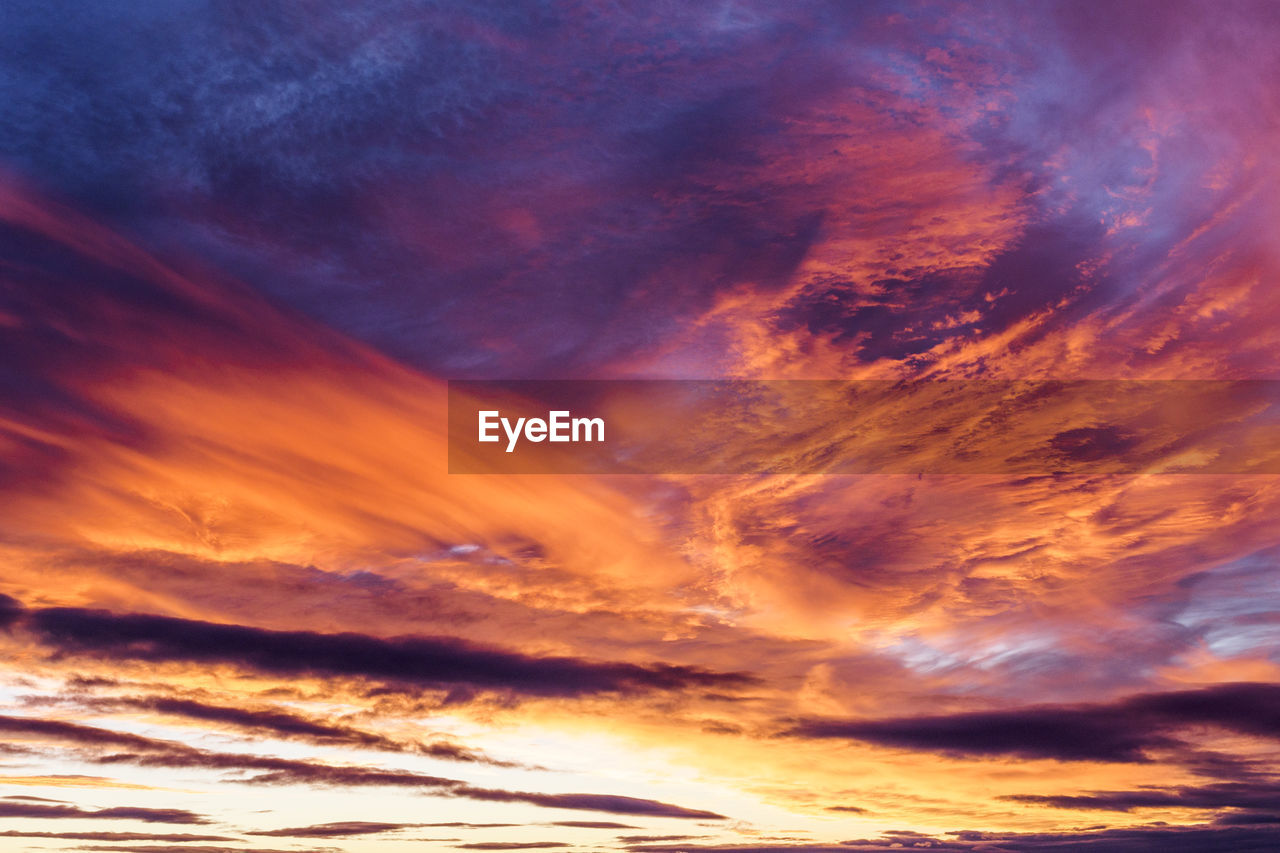 cloud - sky, sky, scenics - nature, beauty in nature, sunset, orange color, dramatic sky, tranquility, nature, tranquil scene, cloudscape, idyllic, low angle view, no people, outdoors, backgrounds, sunlight, moody sky, awe, meteorology, bright