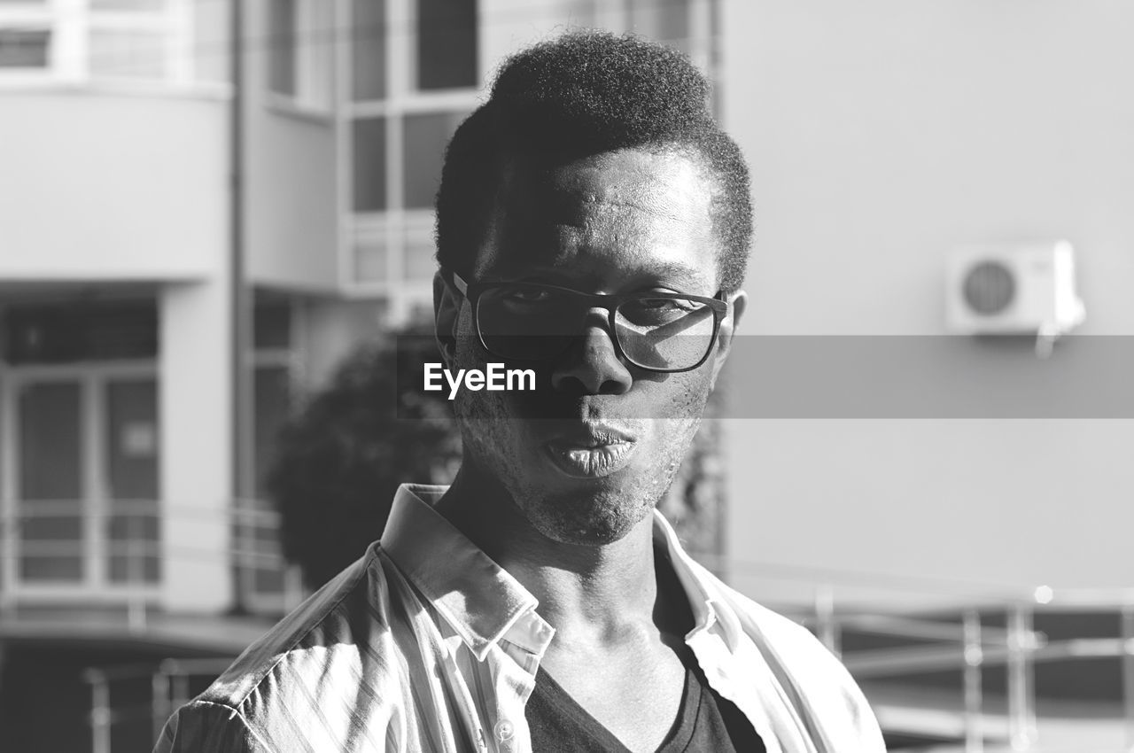 headshot, portrait, eyeglasses, focus on foreground, one person, real people, glasses, young men, front view, young adult, lifestyles, beard, looking at camera, mature men, men, mature adult, close-up, males, contemplation, hairstyle