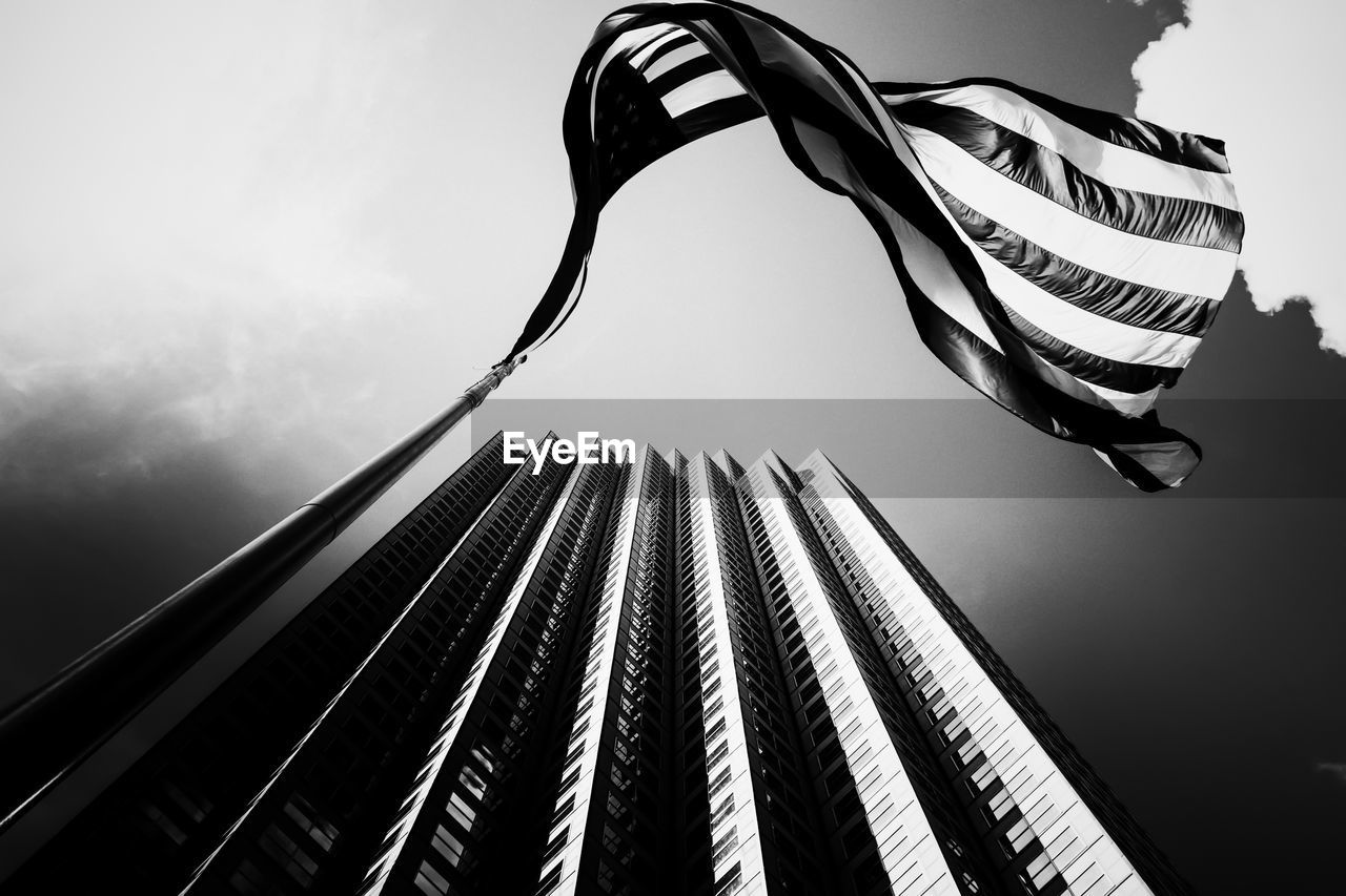 low angle view, sky, flag, outdoors, day, built structure, architecture, no people, building exterior