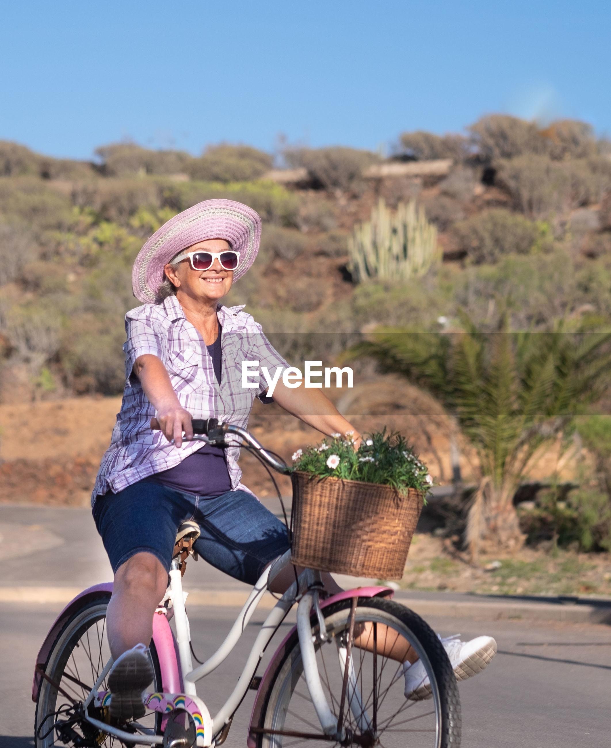 Smiling woman riding bicycle