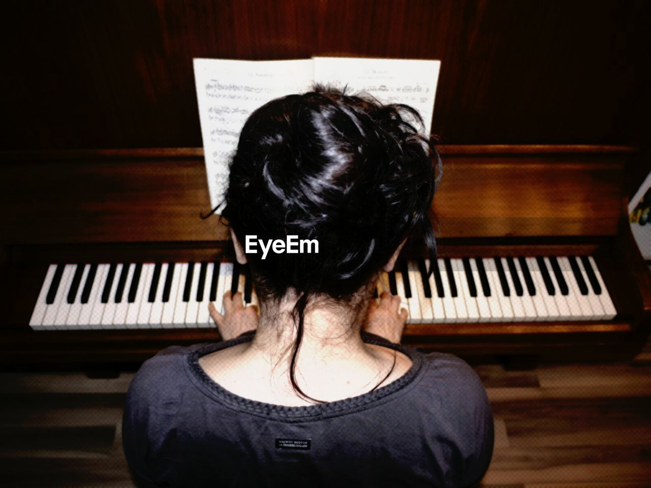 Woman Playing With Piano