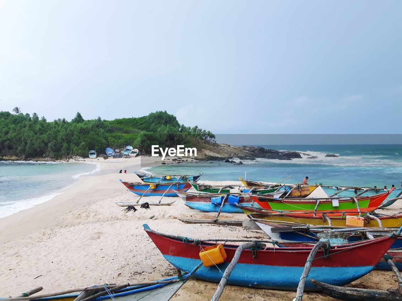 Boats Moored On Shore At Beach