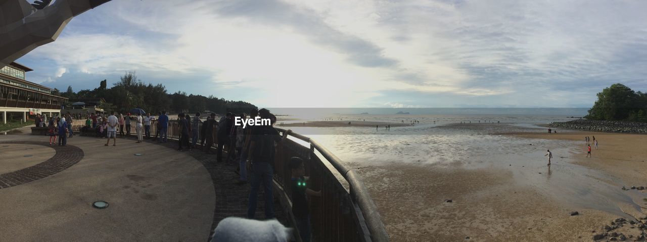 sky, large group of people, water, real people, cloud - sky, sea, day, beach, leisure activity, men, outdoors, nature, people