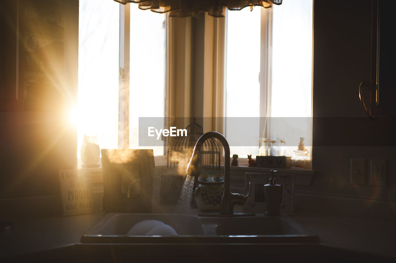 sunlight, indoors, window, curtain, sunbeam, day, table, domestic room, lens flare, no people, architecture, home interior, furniture, nature, house, sun, seat, home, built structure, bright, brightly lit, streaming