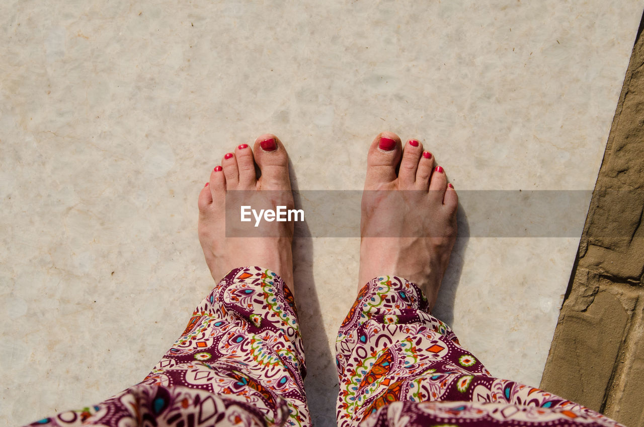 Low Section Of Women With Painted Toenail
