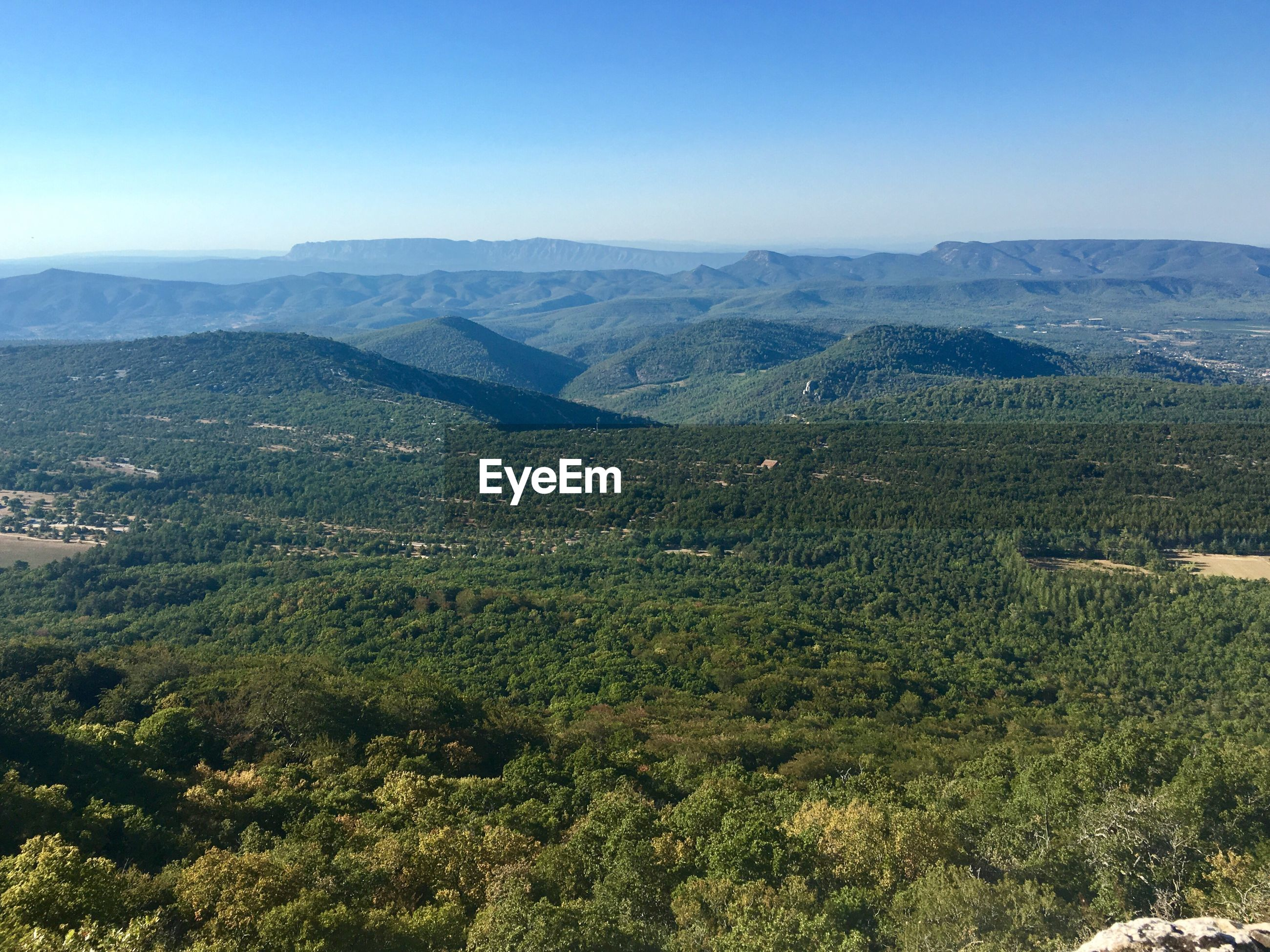mountain, tranquility, tranquil scene, nature, beauty in nature, scenics, landscape, no people, high angle view, day, mountain range, outdoors, tree, clear sky, sky