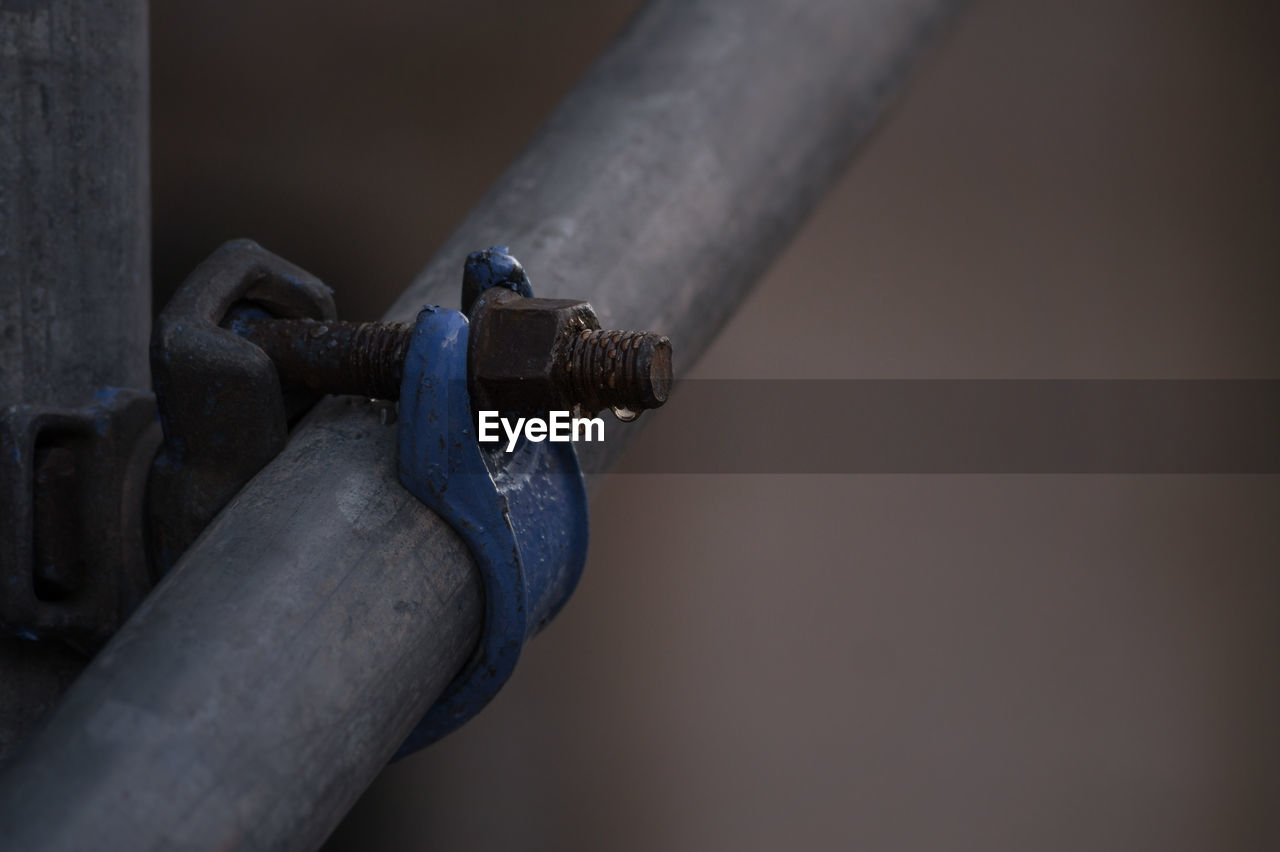 Close-Up Of Pipe Against Blurred Background