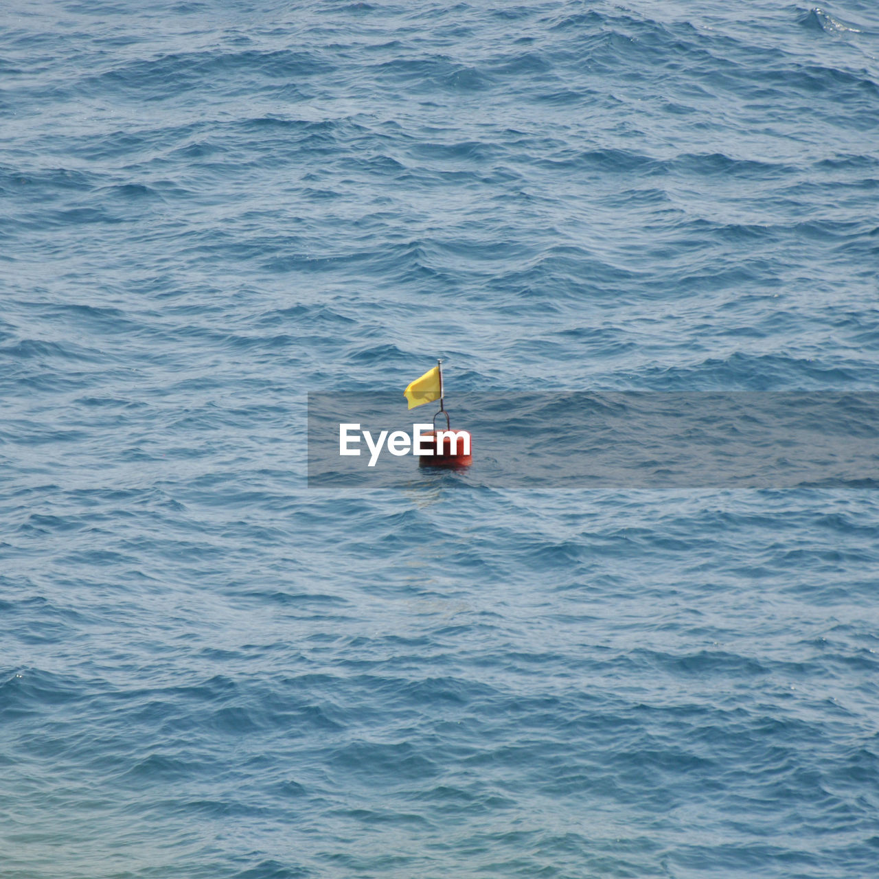 water, floating, floating on water, no people, waterfront, sea, buoy, rippled, nature, day, safety, tranquility, guidance, outdoors, security, single object, protection, tranquil scene, sign