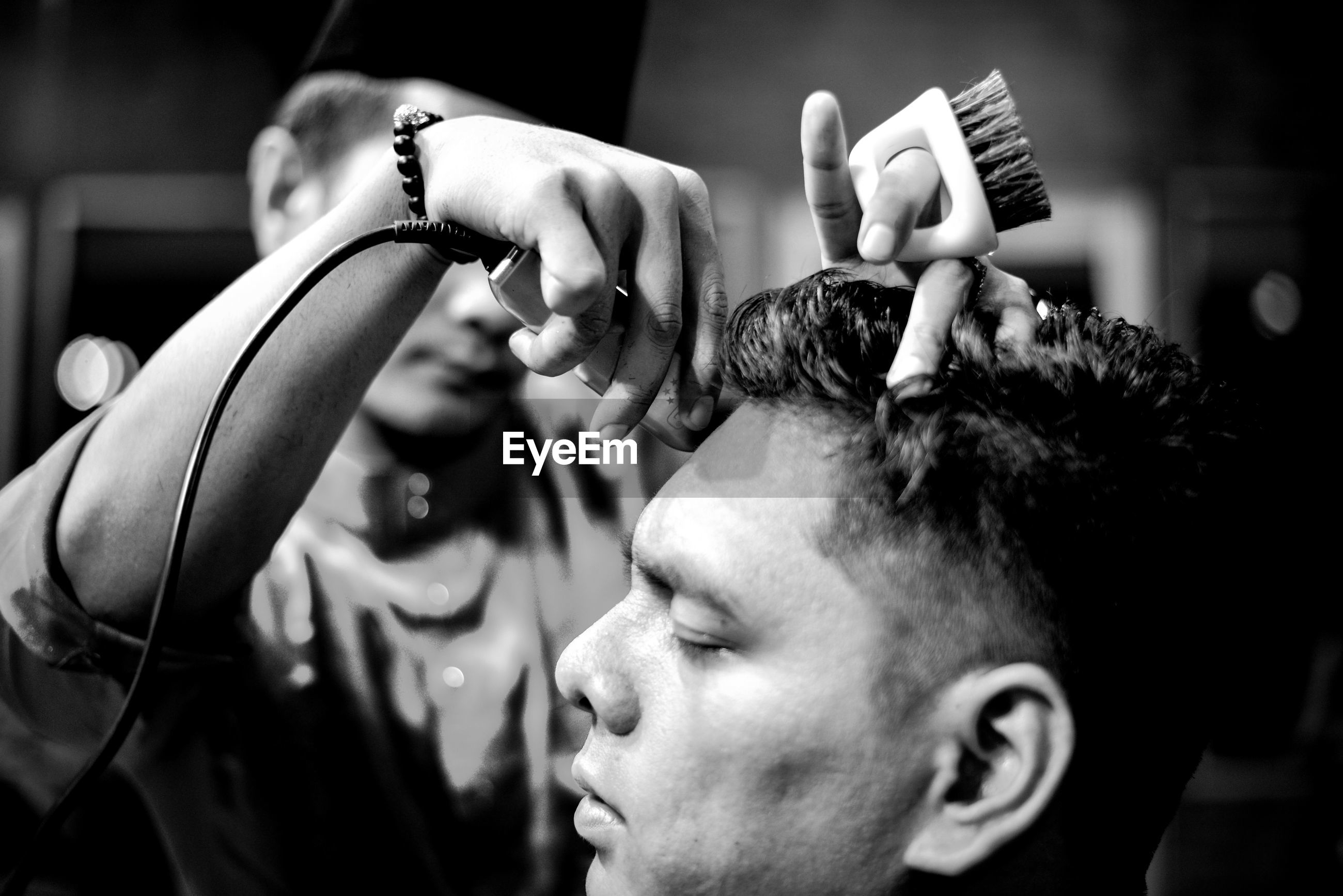 Hairdresser with customer in saloon