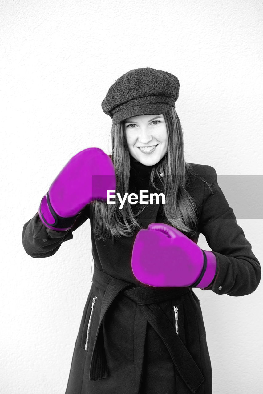 Portrait Of Smiling Woman With Boxing Gloves