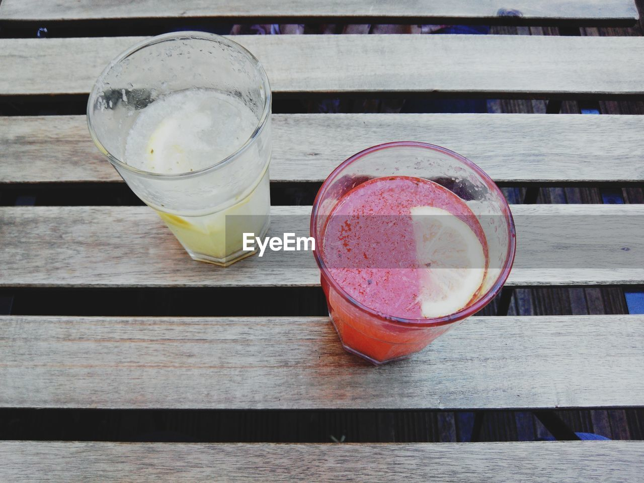 High angle view of two refreshing beverages on a wooden table