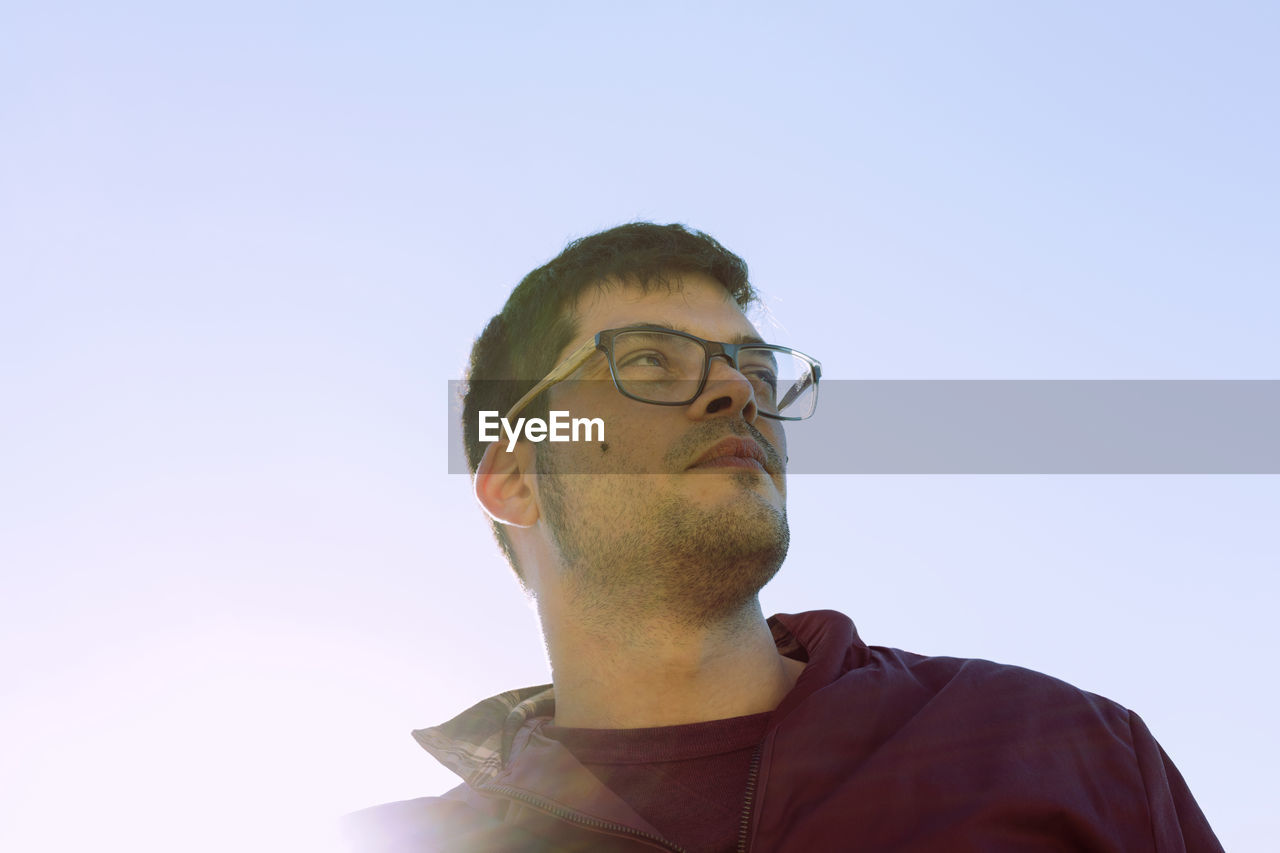 Low Angle View Of Young Man Against Sky