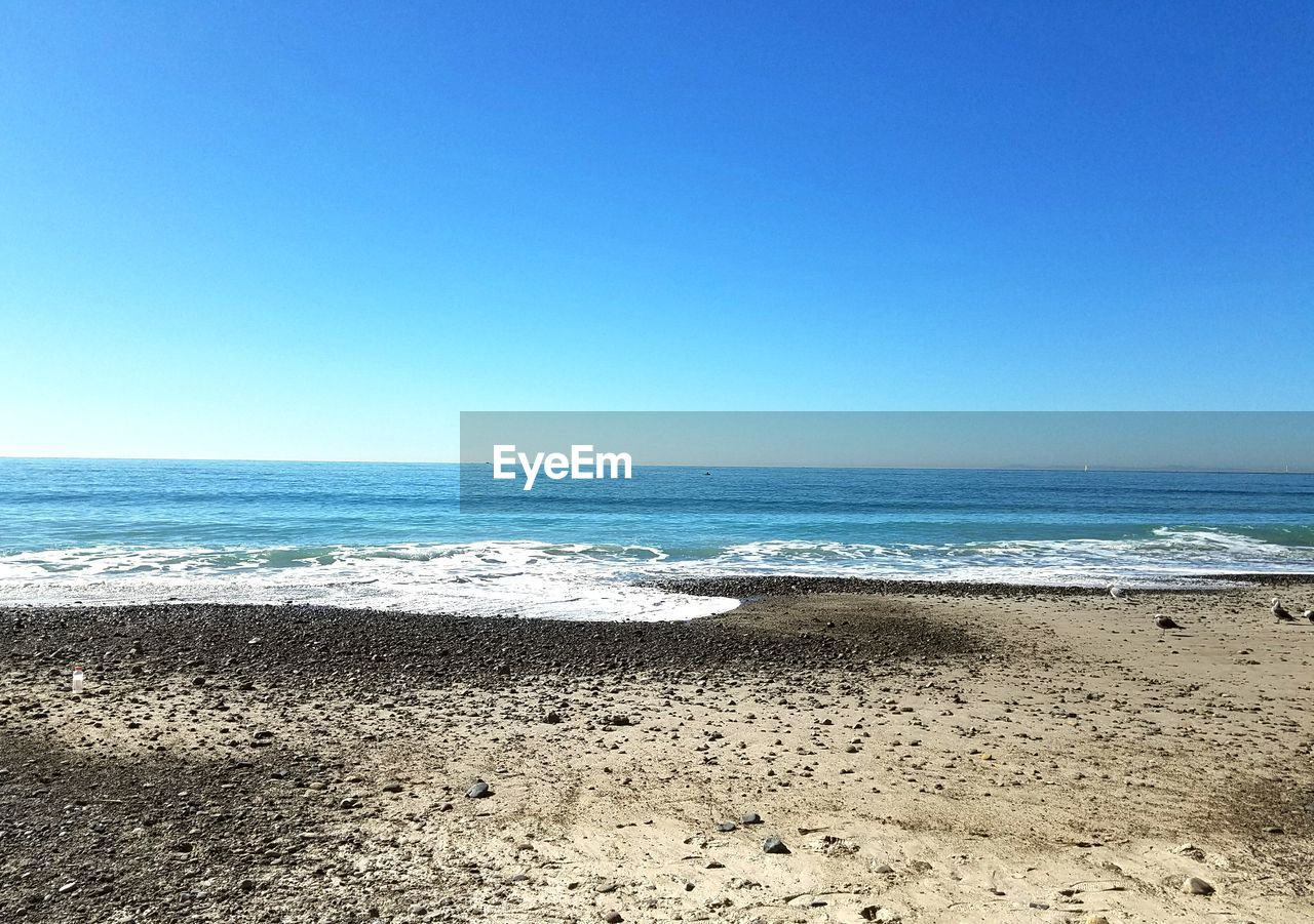 sea, beach, sand, horizon over water, nature, water, copy space, beauty in nature, shore, scenics, tranquility, clear sky, blue, tranquil scene, wave, no people, day, sunlight, outdoors, summer, sky