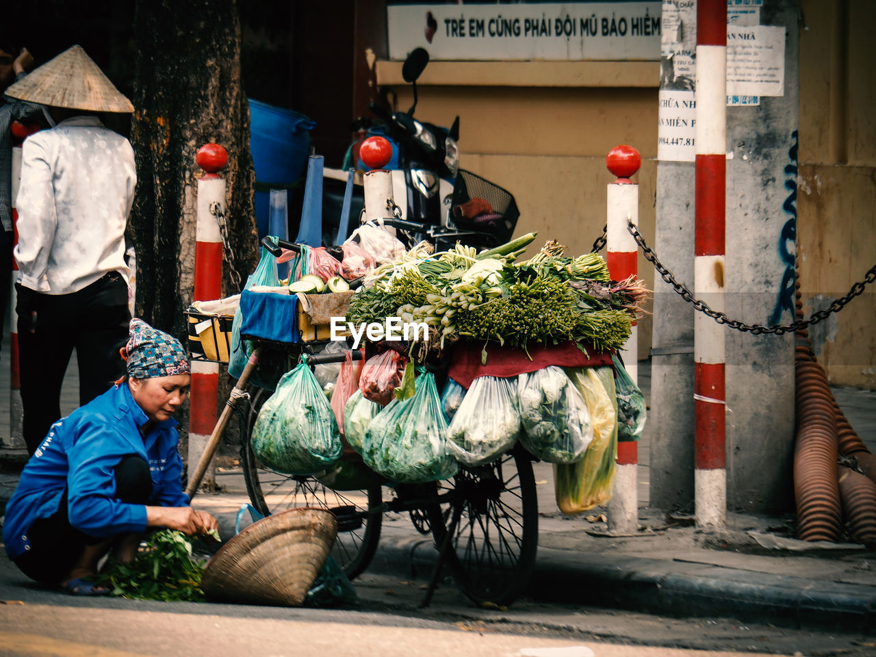 men, real people, mode of transportation, people, city, transportation, day, vegetable, food and drink, street, food, occupation, retail, land vehicle, architecture, market, for sale, incidental people, healthy eating, outdoors