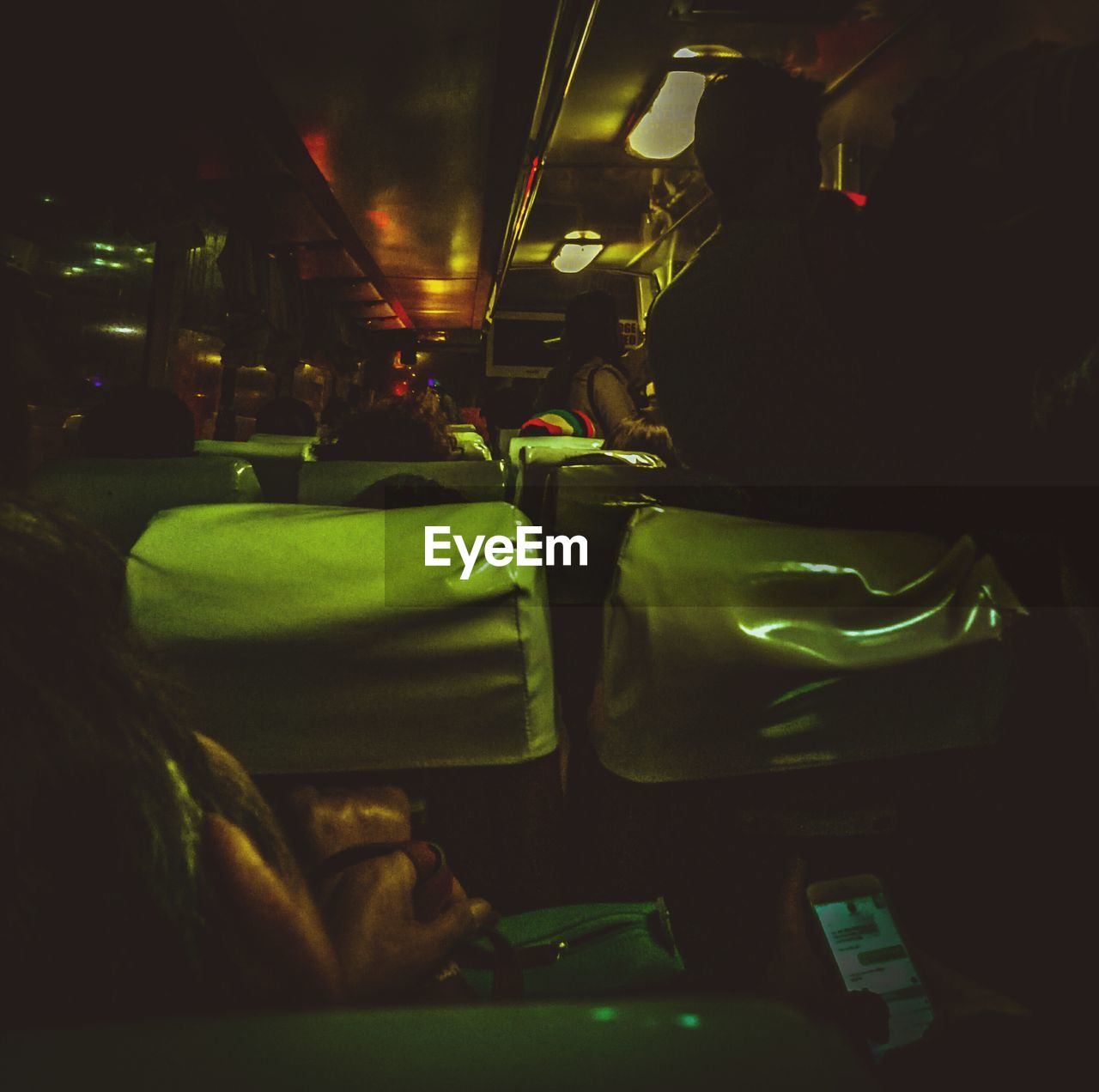 vehicle interior, illuminated, real people, transportation, indoors, mode of transport, night, men, vehicle seat, one person, people