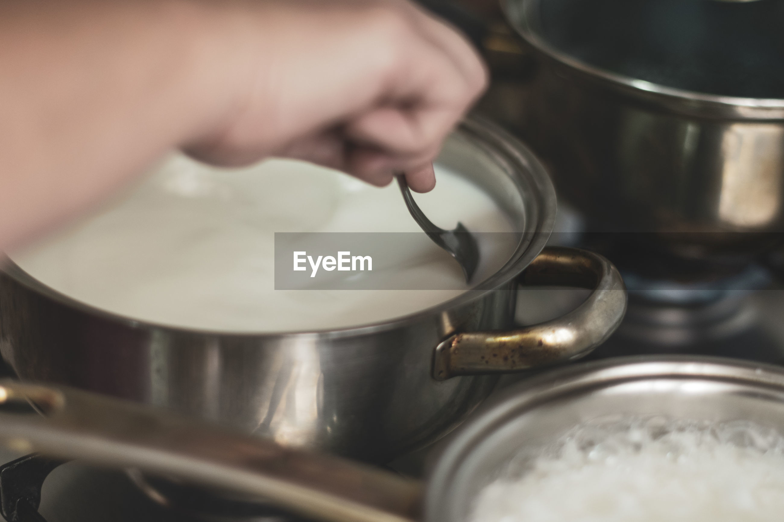 Cropped hand of person preparing food at home