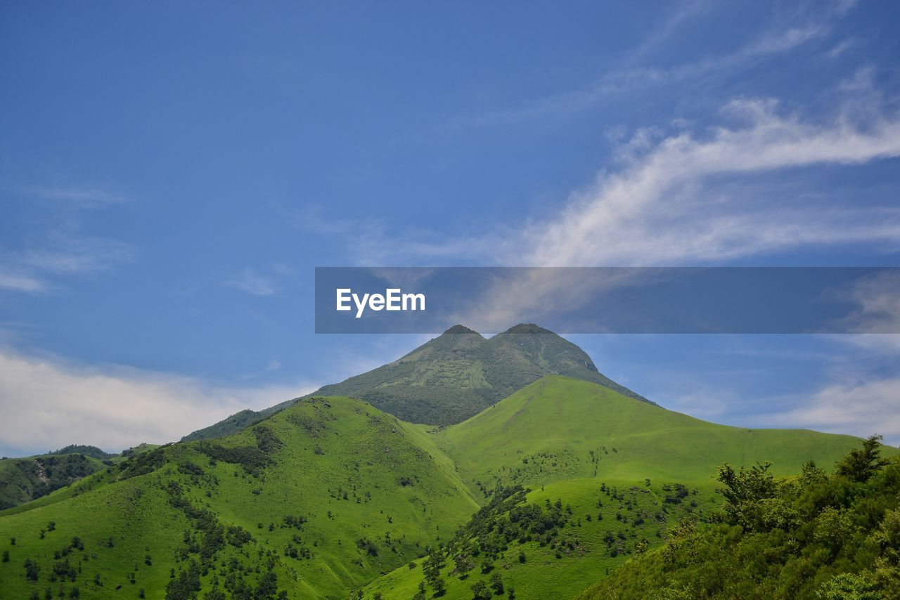 sky, mountain, tranquil scene, scenics - nature, beauty in nature, tranquility, cloud - sky, plant, green color, non-urban scene, tree, nature, landscape, no people, environment, day, idyllic, blue, remote, land, outdoors, mountain peak, mountain ridge