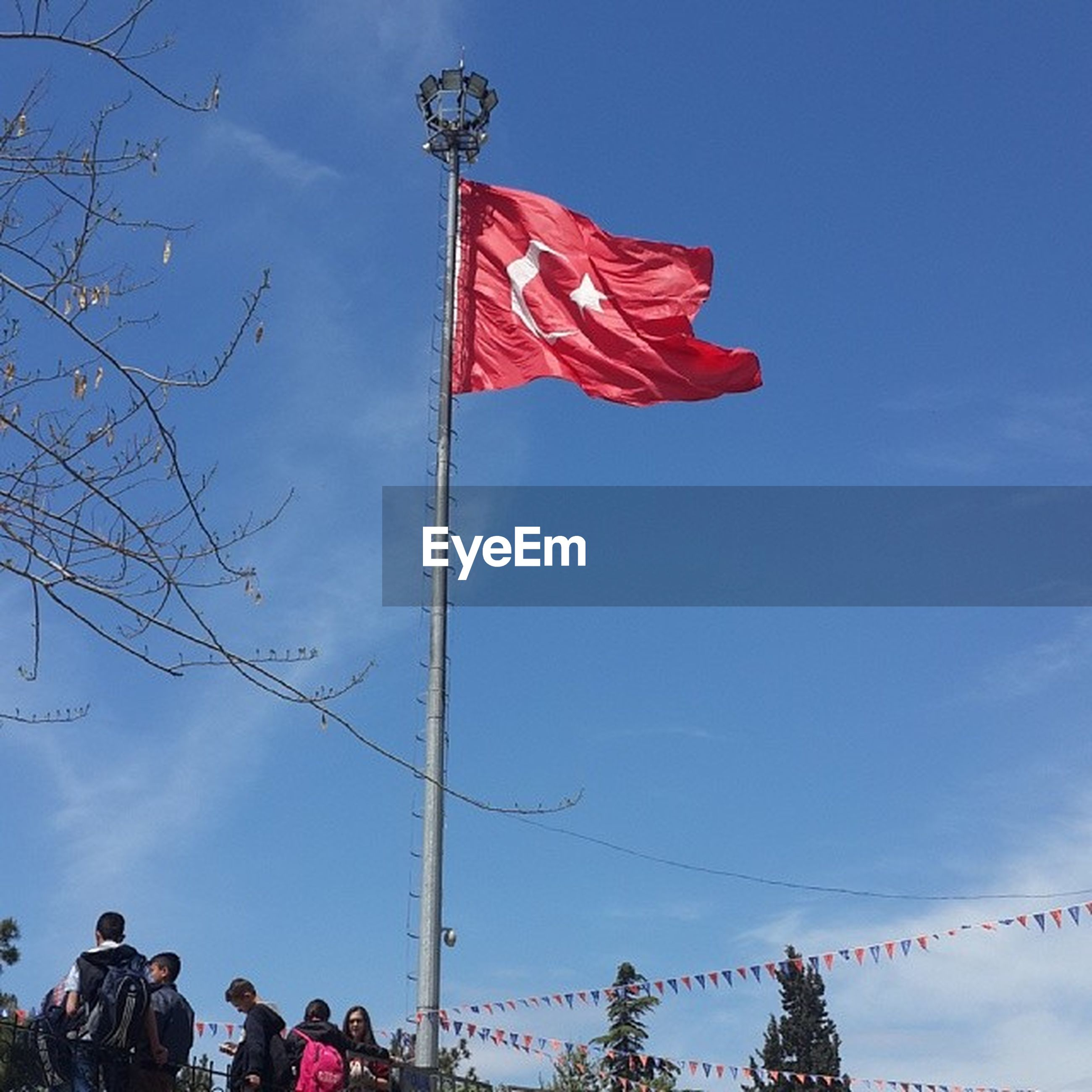 flag, patriotism, low angle view, national flag, identity, american flag, sky, blue, wind, pride, pole, culture, red, waving, flag pole, freedom, day, clear sky, cloud, striped