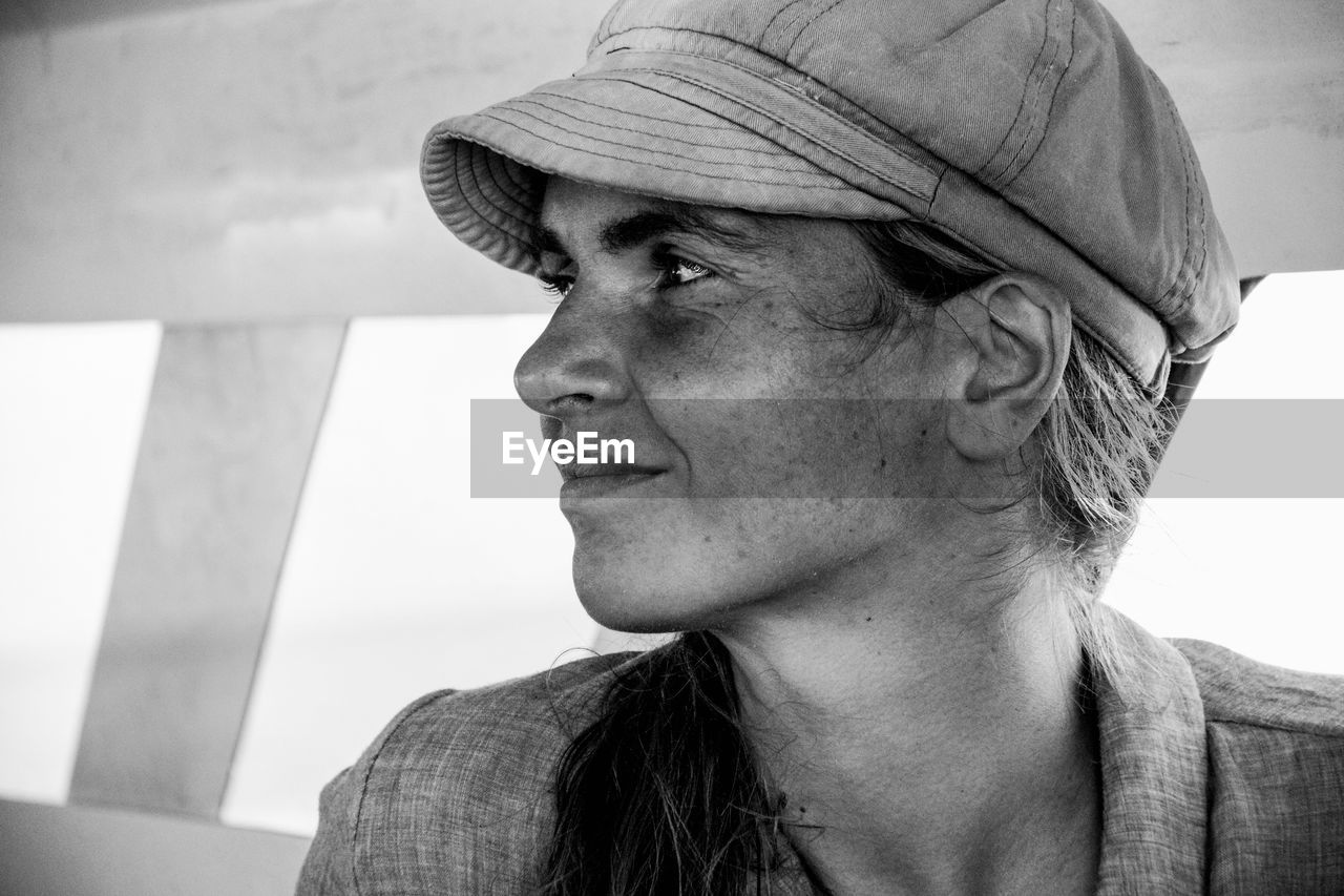headshot, looking away, portrait, looking, one person, lifestyles, real people, close-up, focus on foreground, hat, front view, clothing, contemplation, adult, day, leisure activity, casual clothing, males, human face, hairstyle