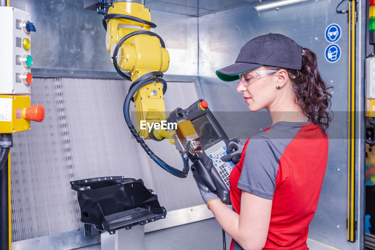 Technician Working On Machinery In Factory