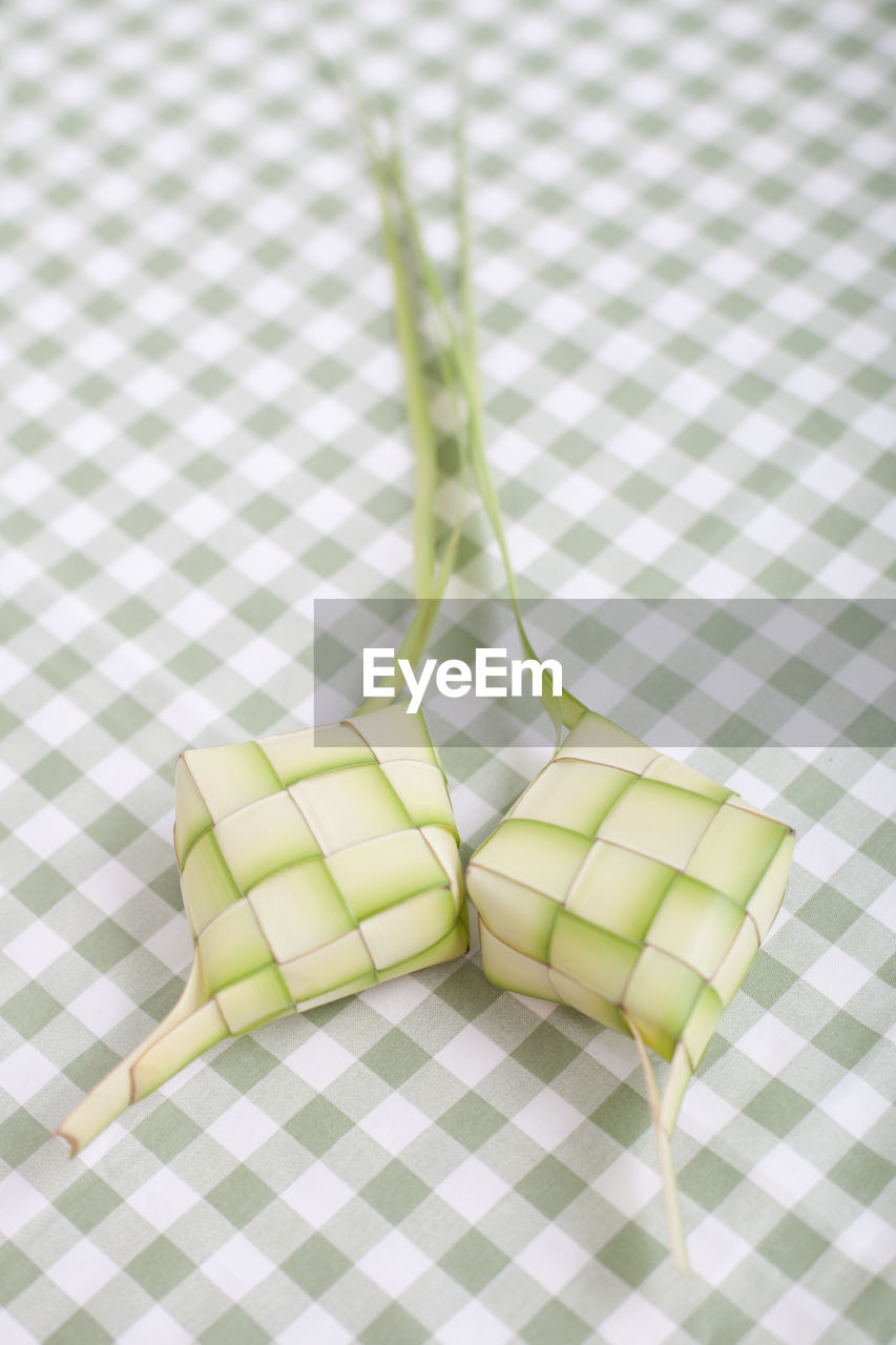 checked pattern, no people, green color, indoors, tablecloth, close-up, day