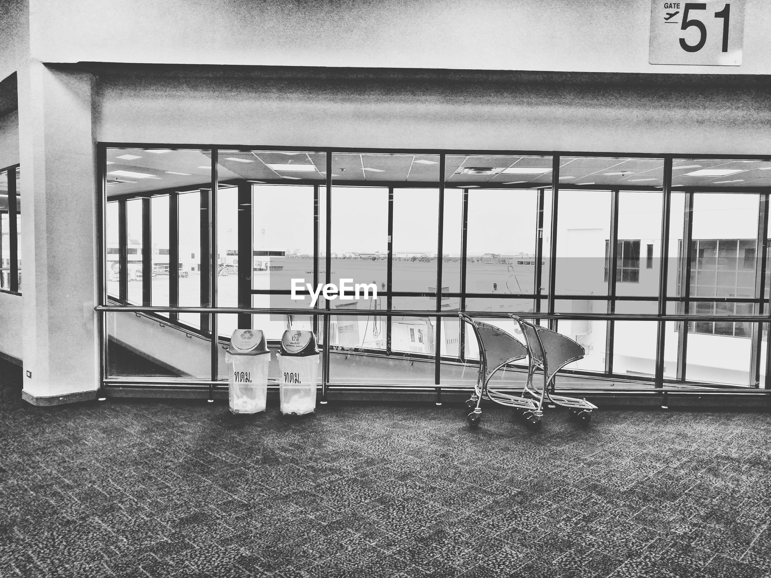 Trolley and garbage cans at airport