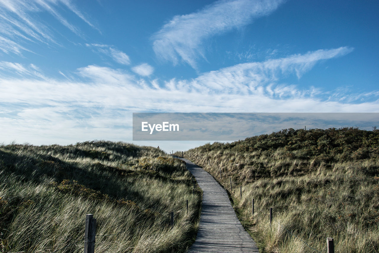 the way forward, cloud - sky, direction, sky, tranquility, tranquil scene, beauty in nature, scenics - nature, no people, day, nature, footpath, plant, landscape, environment, non-urban scene, land, outdoors, diminishing perspective, boardwalk, long