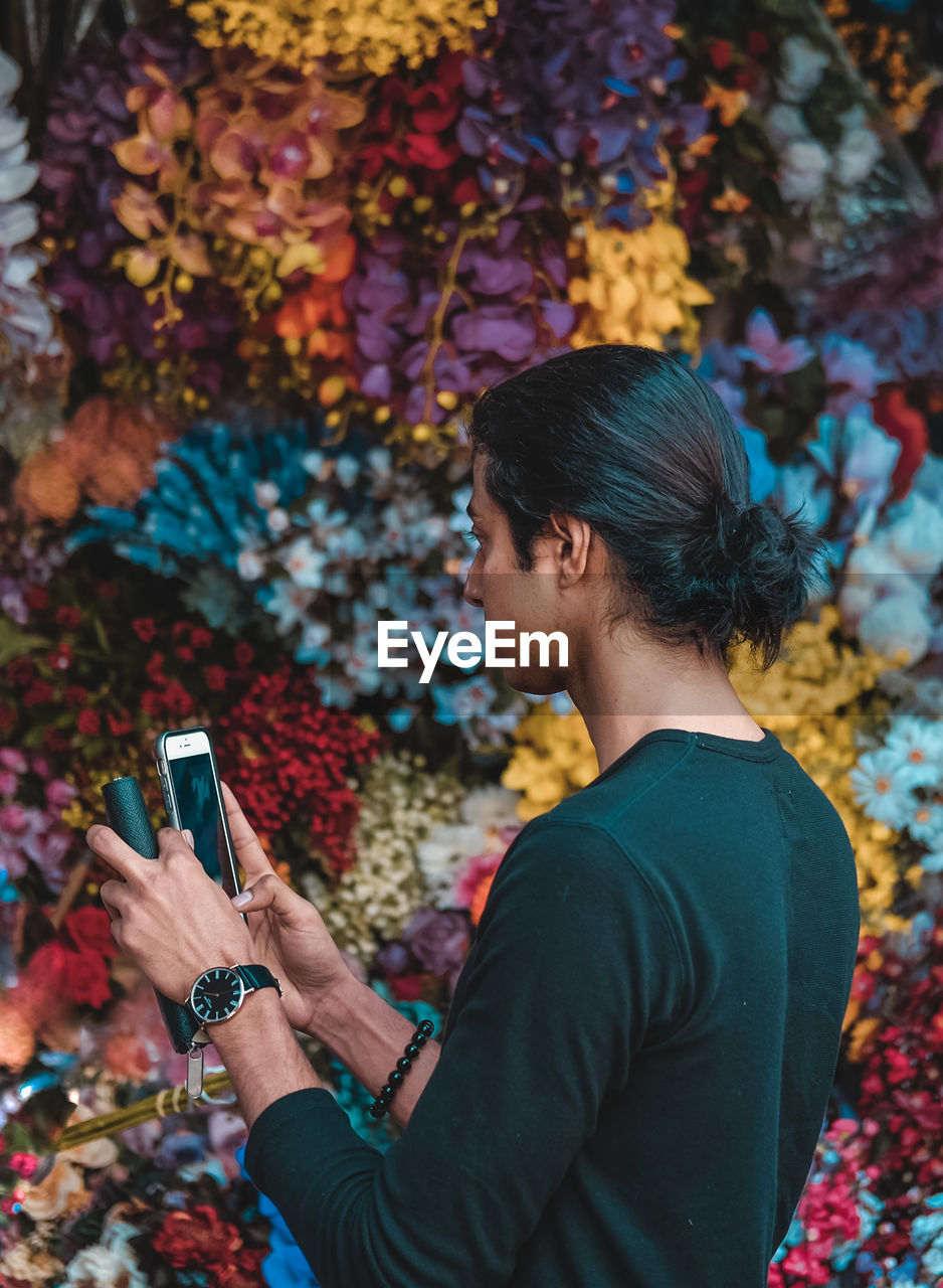 mobile phone, real people, one person, technology, lifestyles, autumn, leisure activity, young adult, smart phone, telephone, holding, using phone, connection, wireless technology, portable information device, casual clothing, adult, young women, day, outdoors, change, leaves
