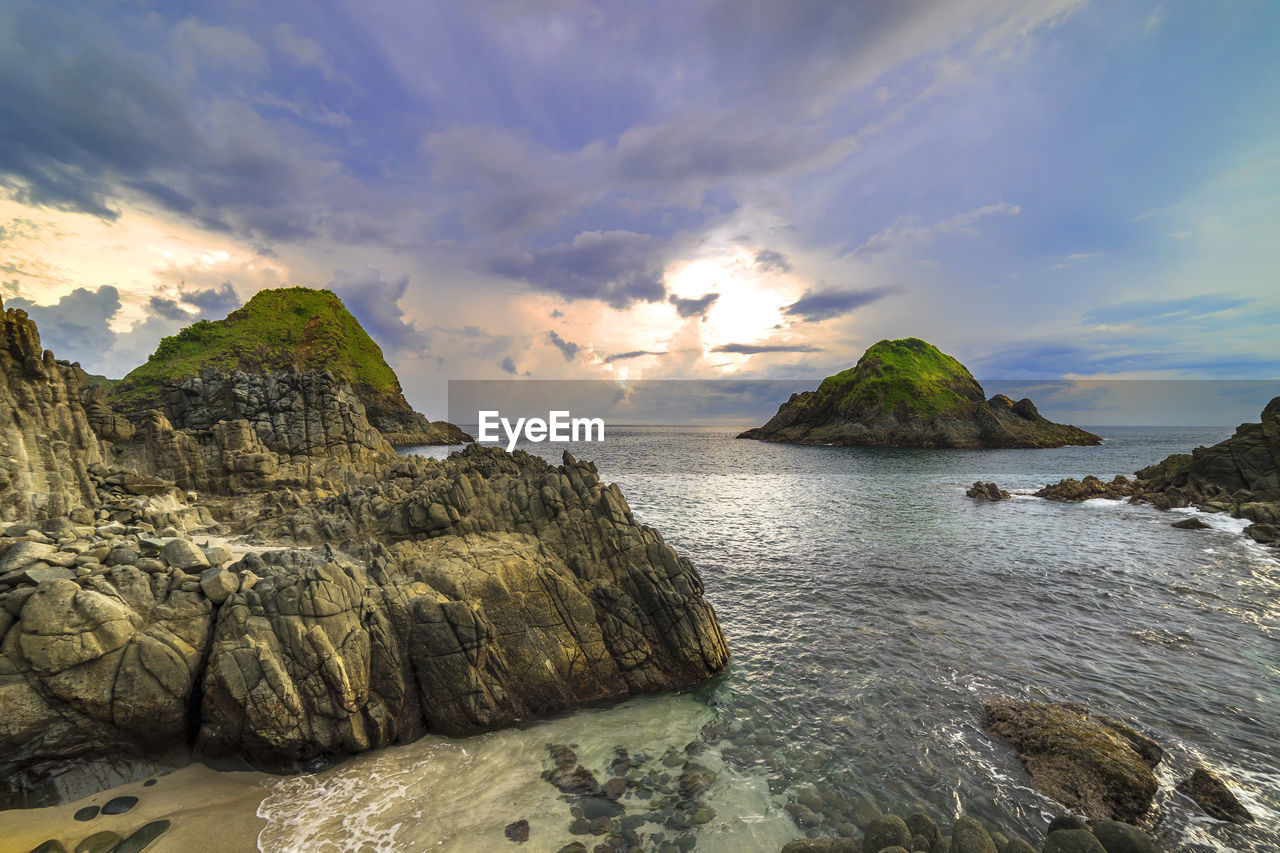 sea, nature, sky, beauty in nature, scenics, tranquility, rock - object, rock, tranquil scene, water, cliff, no people, cloud - sky, scenery, mountain, outdoors, sunset, horizon over water, day