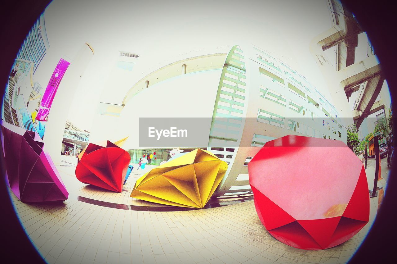 multi colored, indoors, no people, low angle view, fish-eye lens, built structure, red, architecture, day, modern, close-up