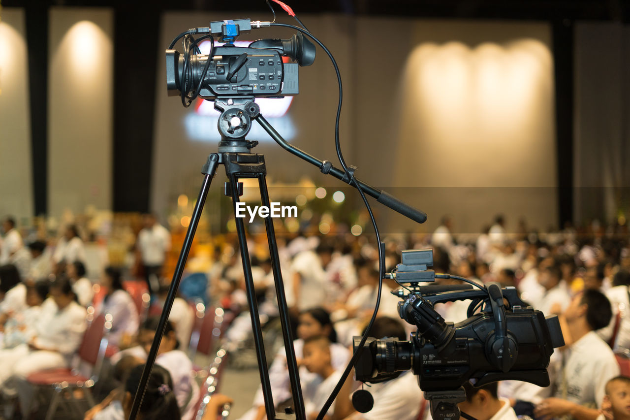Low angle view of television camera in auditorium