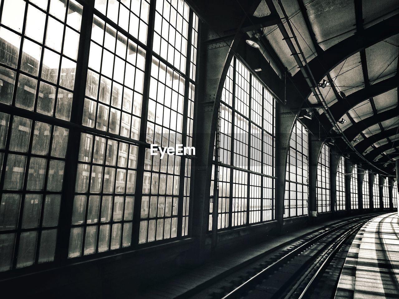 Railroad station platform seen through glass window