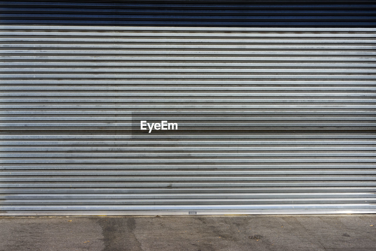 pattern, closed, metal, corrugated iron, architecture, no people, iron, shutter, wall - building feature, day, built structure, security, backgrounds, silver colored, garage, safety, textured, industry, building exterior, city, corrugated, alloy, steel