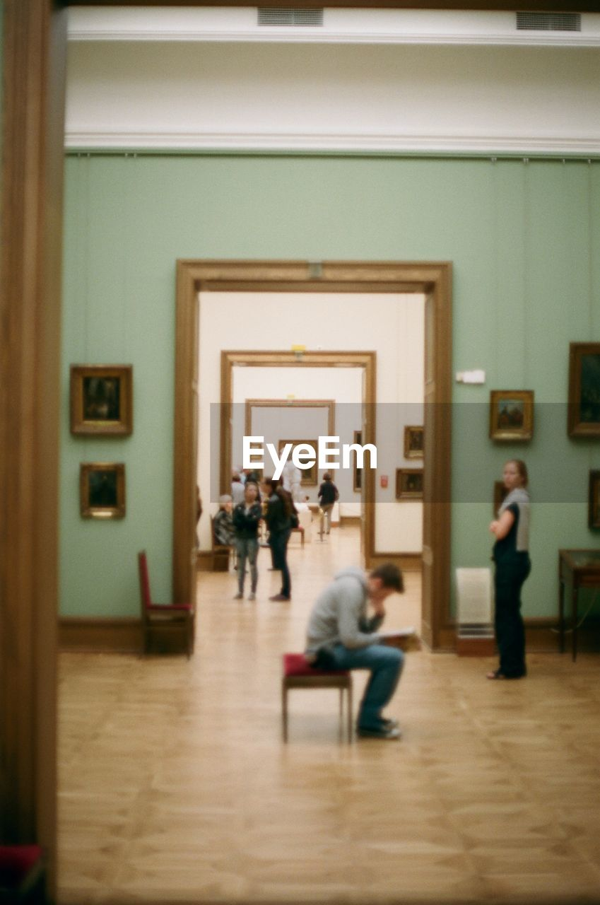 indoors, real people, museum, men, women, architecture, day, people