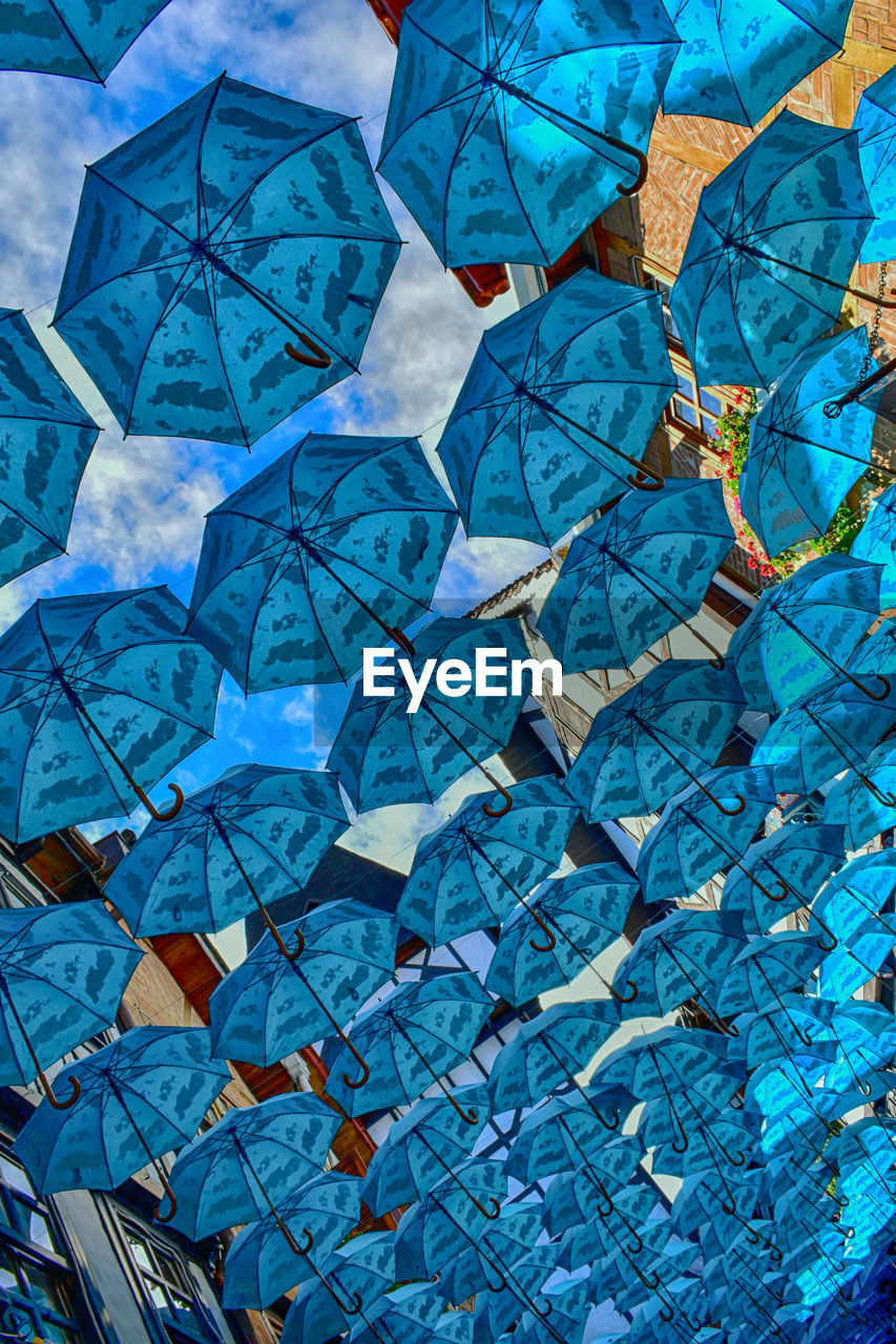 full frame, backgrounds, blue, no people, pattern, large group of objects, art and craft, creativity, paper, close-up, day, low angle view, indoors, nature, craft, design, shape, multi colored, abundance, turquoise colored, ceiling